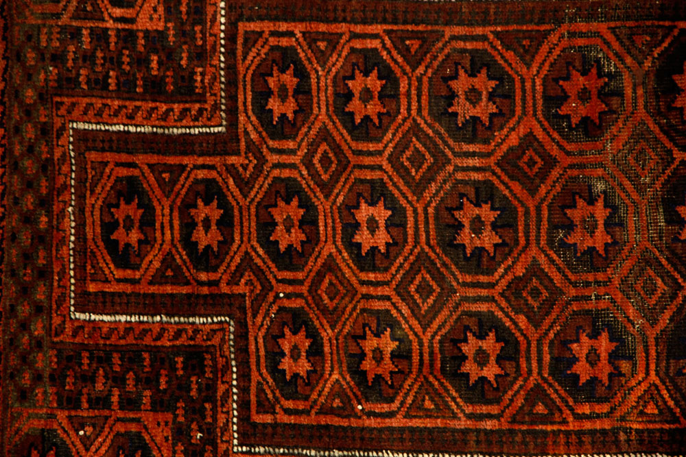 Small Baluch carpet, Afghanistan, in rust red