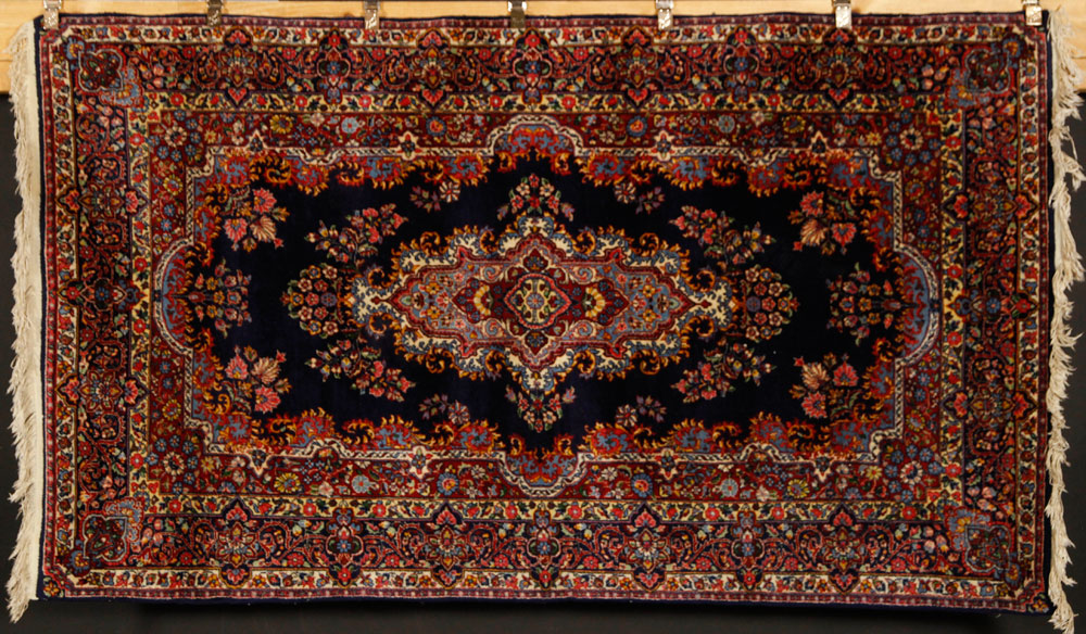 Keshan or Kerman carpet, Persian, navy blue with rose and ivory accents