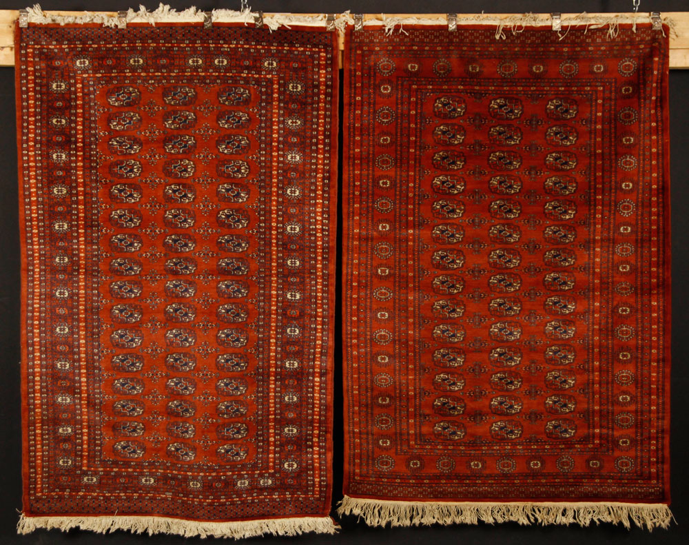 Pair of Bokhara carpets, Pakistan, rust red with elephant foot gulls