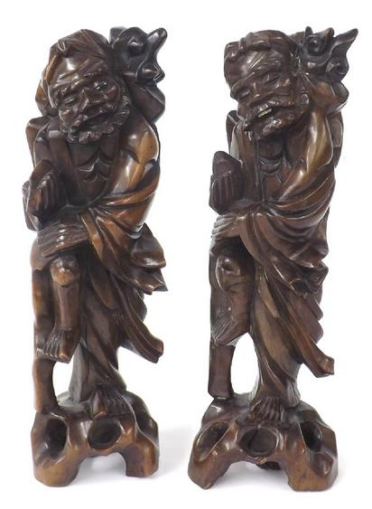 Matched pair of Oriental carved hardwood figures of old men, one with open mouth and teeth (2)