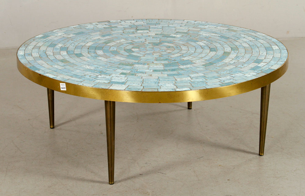 Modern tile top table, circular top on four legs, color tiles with brass banded edge