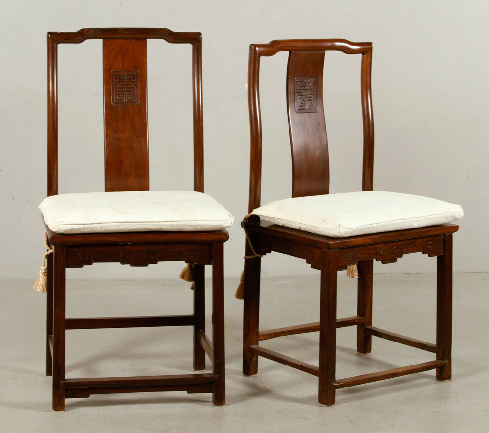 Pair of wooden chairs, Chinese, with cream-colored seat pillows