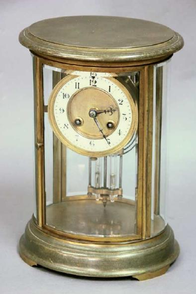 A BRASS FOUR PANE MANTLE CLOCK