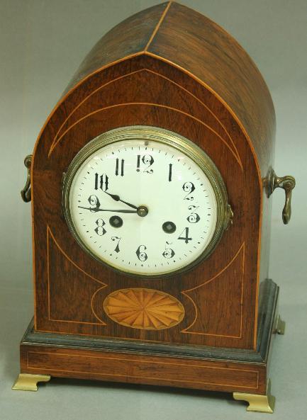AN EDWARDIAN MANTLE CLOCK