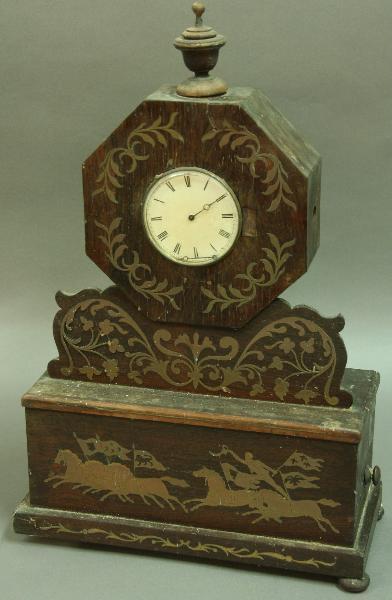 A MAHOGANY VENEERED AND BRASS INLAID CLOCK