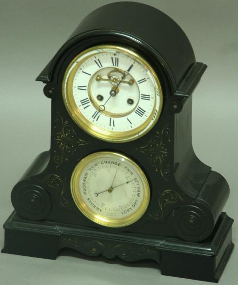 A BLACK MARBLE MANTLE CLOCK