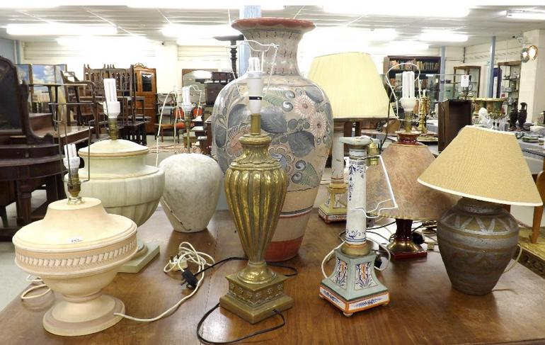 Large collection of various pottery and ceramic table lamps of various forms