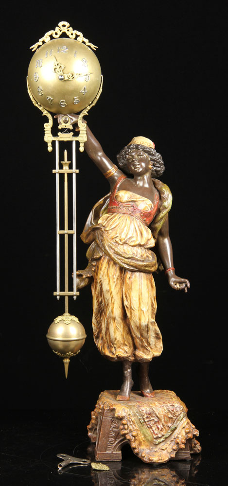 Victorian figural mystery ball swing clock, cast metal with original polychrome paint