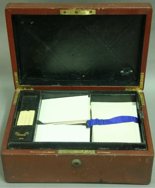 A VICTORIAN LEATHER AND BRASS BOUND WRITING BOX