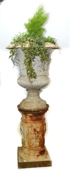 A CAST IRON URN ON STAND