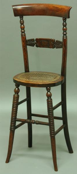 A CHILD'S HIGH CHAIR