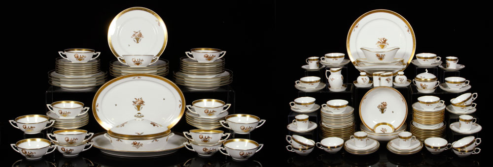 Large set of Royal Copenhagen dinnerware, decorated with gold border and baskets of flowers