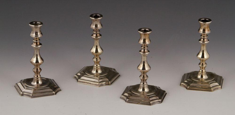 Four Queen Anne-style miniature candlesticks