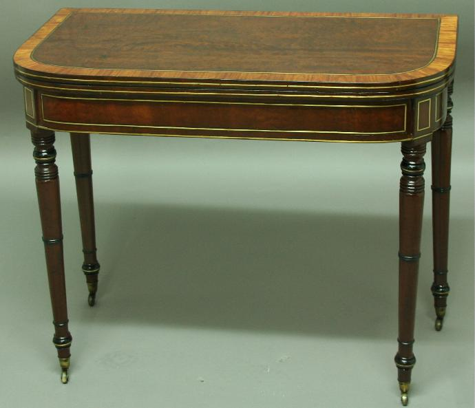 A REGENCY MAHOGANY AND SATINWOOD INLAID FOLD OUT CARD TABLE