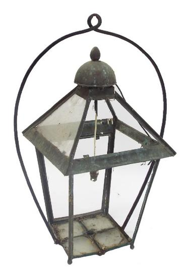 Antique patinated copper hanging lantern of typical form with arched hanging bracket