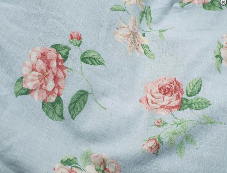 Collection of good quality Jane Churchill curtains decorated with pink roses upon a sky blue ground