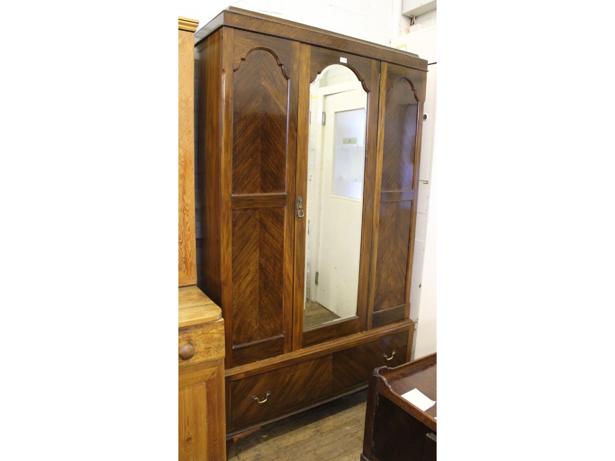 A stained Wood 1920's mirror door wardrobe, with drawer below and cabriole legs