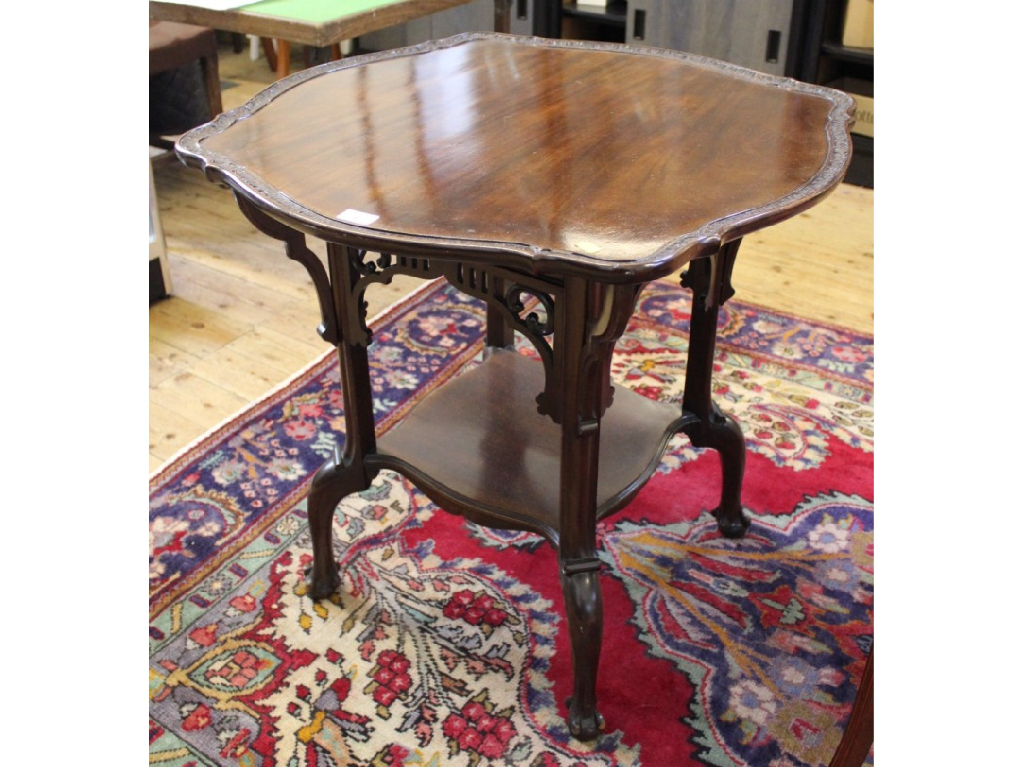 An Edwardian mahogany occasional table