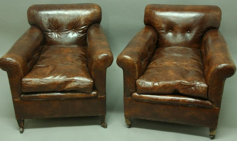A PAIR OF BROWN LEATHER CLUB CHAIRS