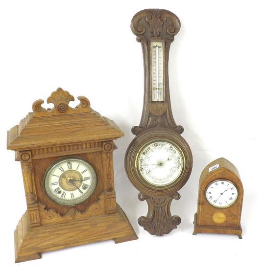 Burr walnut lancet mantel clock, inlaid with a conch shell