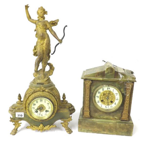 French gilt metal and onyx two train figural mantel clock, mounted by Diana
