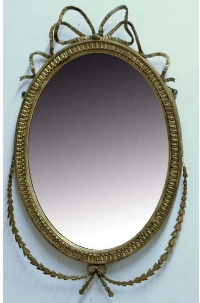 A NEOCLASSICAL GILT GESSO OVAL WALL MIRROR