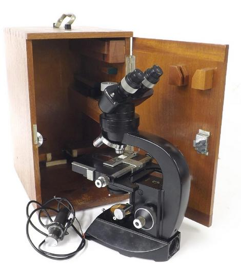 Good cased binocular microscope