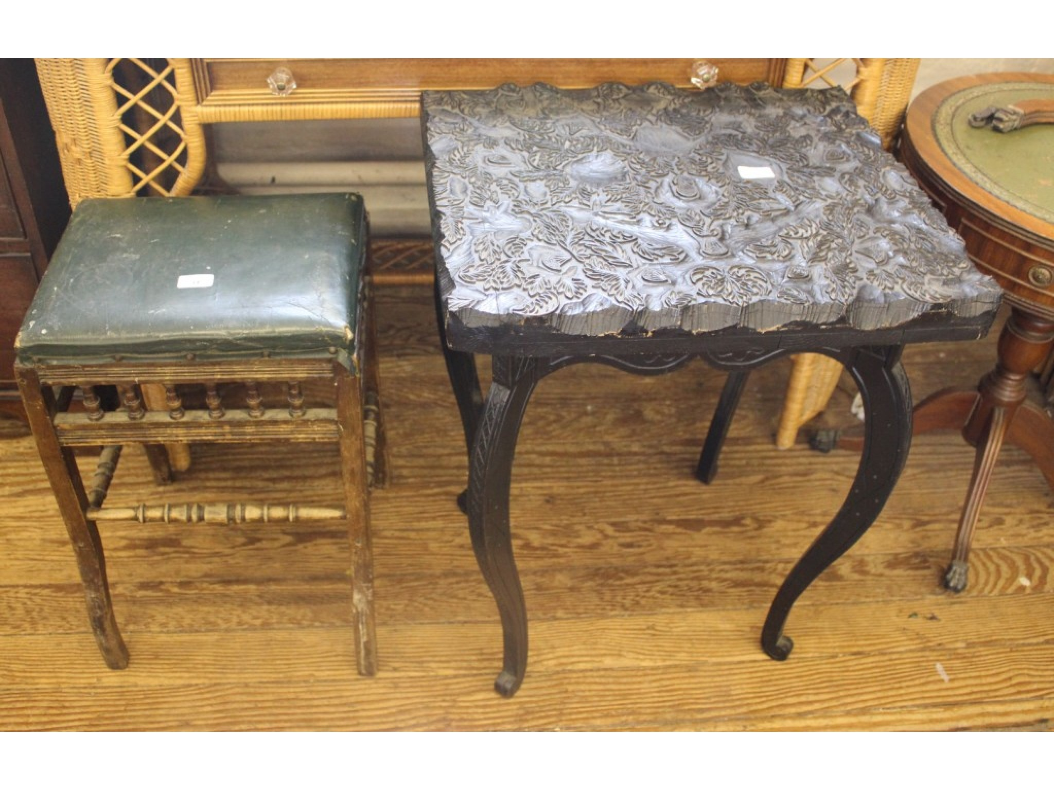 A deep carved ebony occasional table and an Edwardian stool