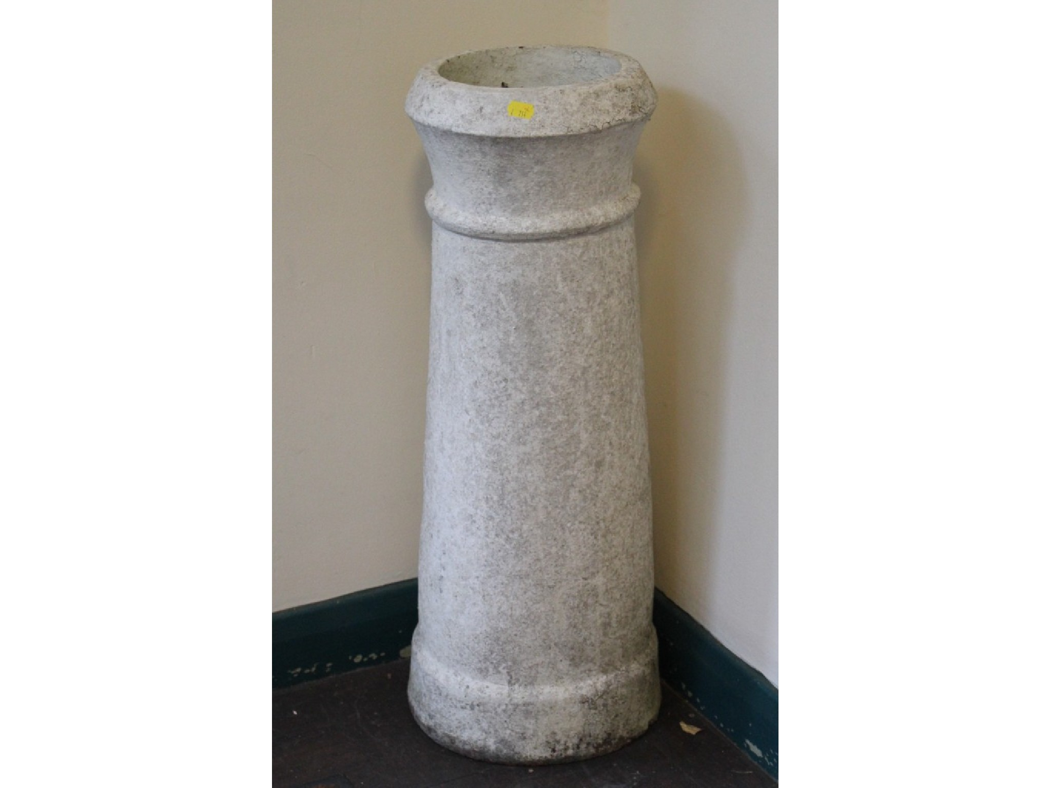 A white painted tapering chimney pot