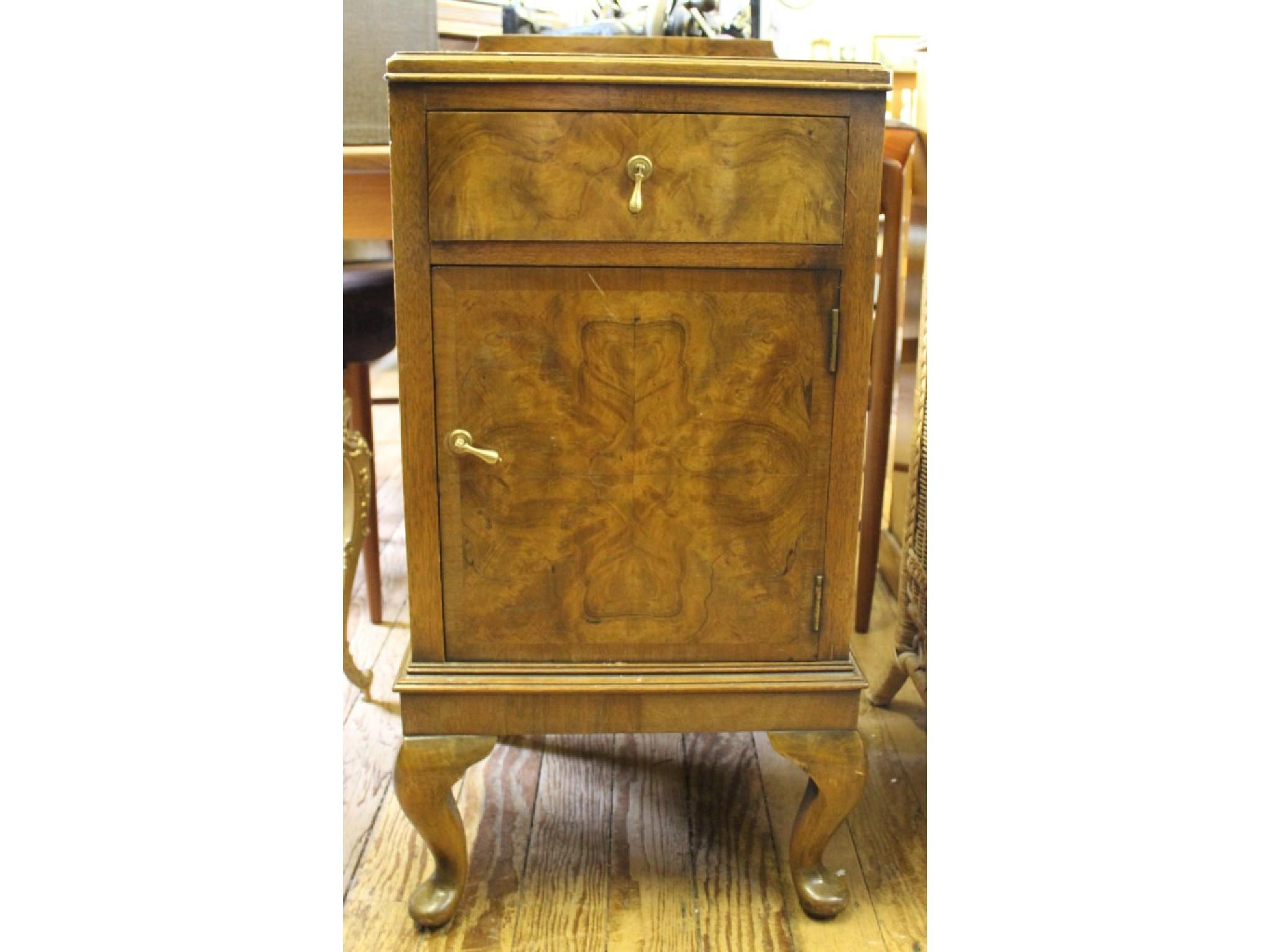 A crossbanded walnut night cupboard