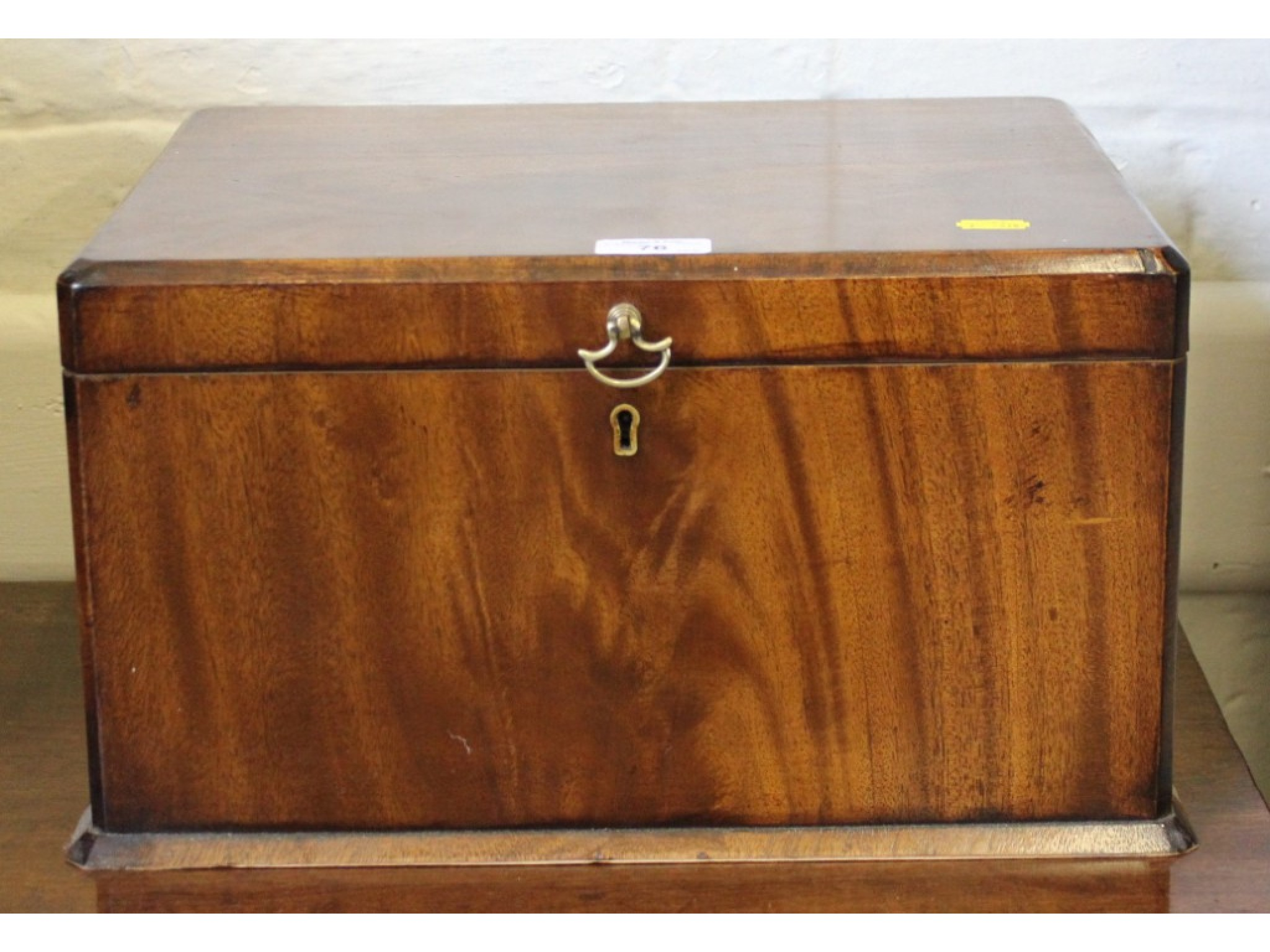 A mahogany rectangular sewing box, with brass handle and partial silk lined interior