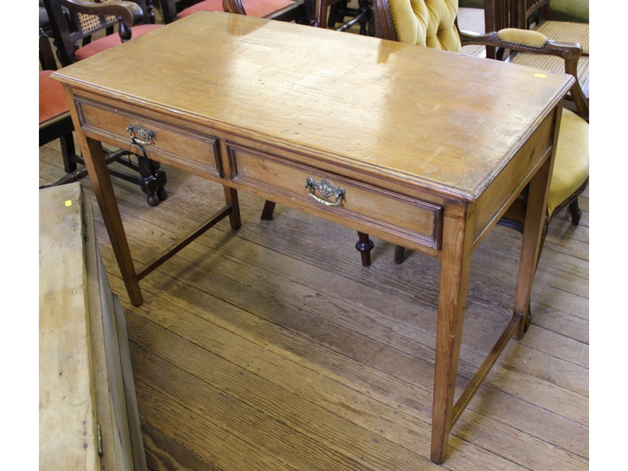 An Edwardian pine washstand, the rectangular top over two frieze drawers on square legs