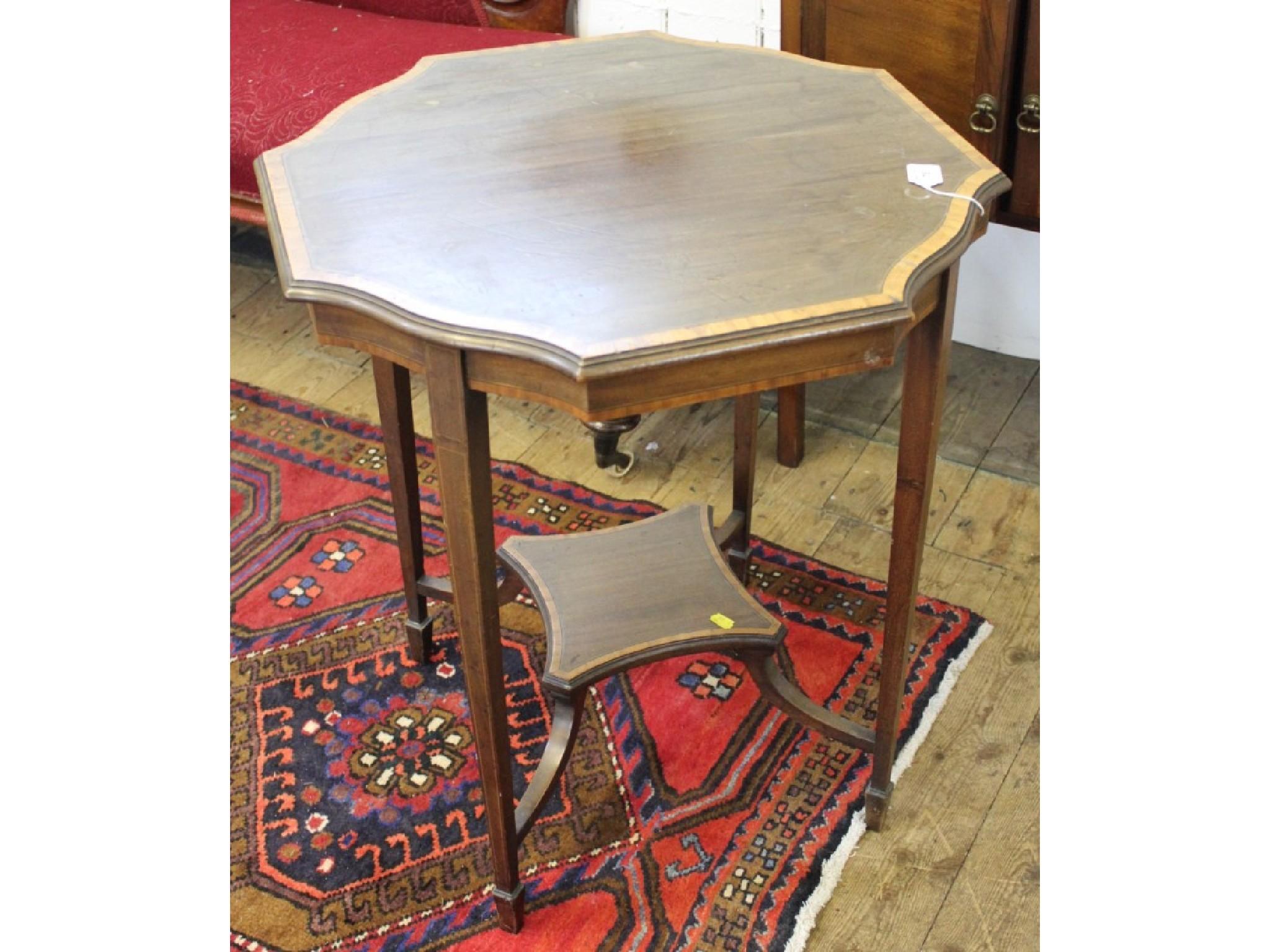 An octagonal wavy-rim crossbanded centre table