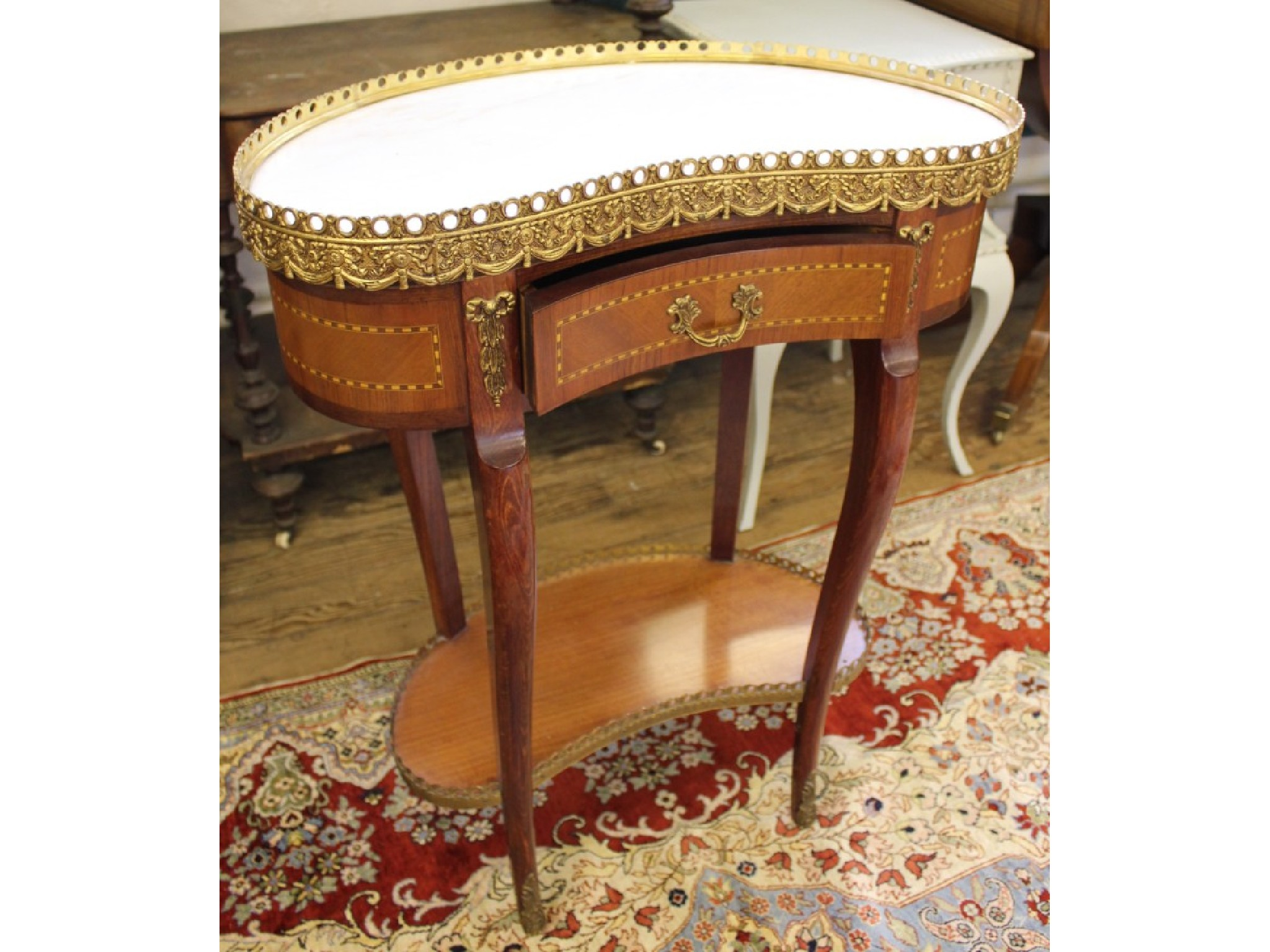 French style kidney shape side table, the white marble top with gilt metal gallery over frieze drawers and mounted cabriole legs