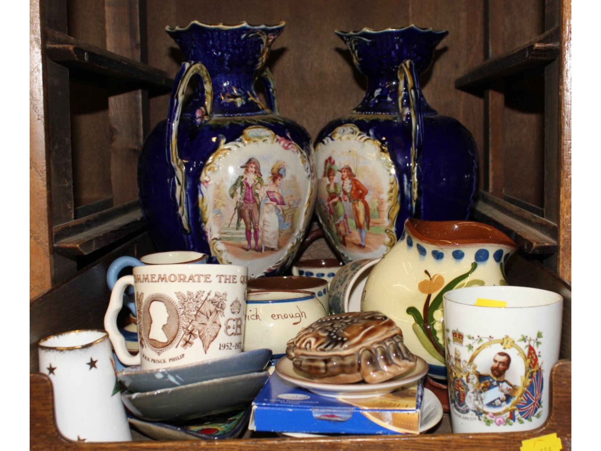 A collection of ceramics including Torquay Pottery, a pair of Victorian style vases and commemorative wares