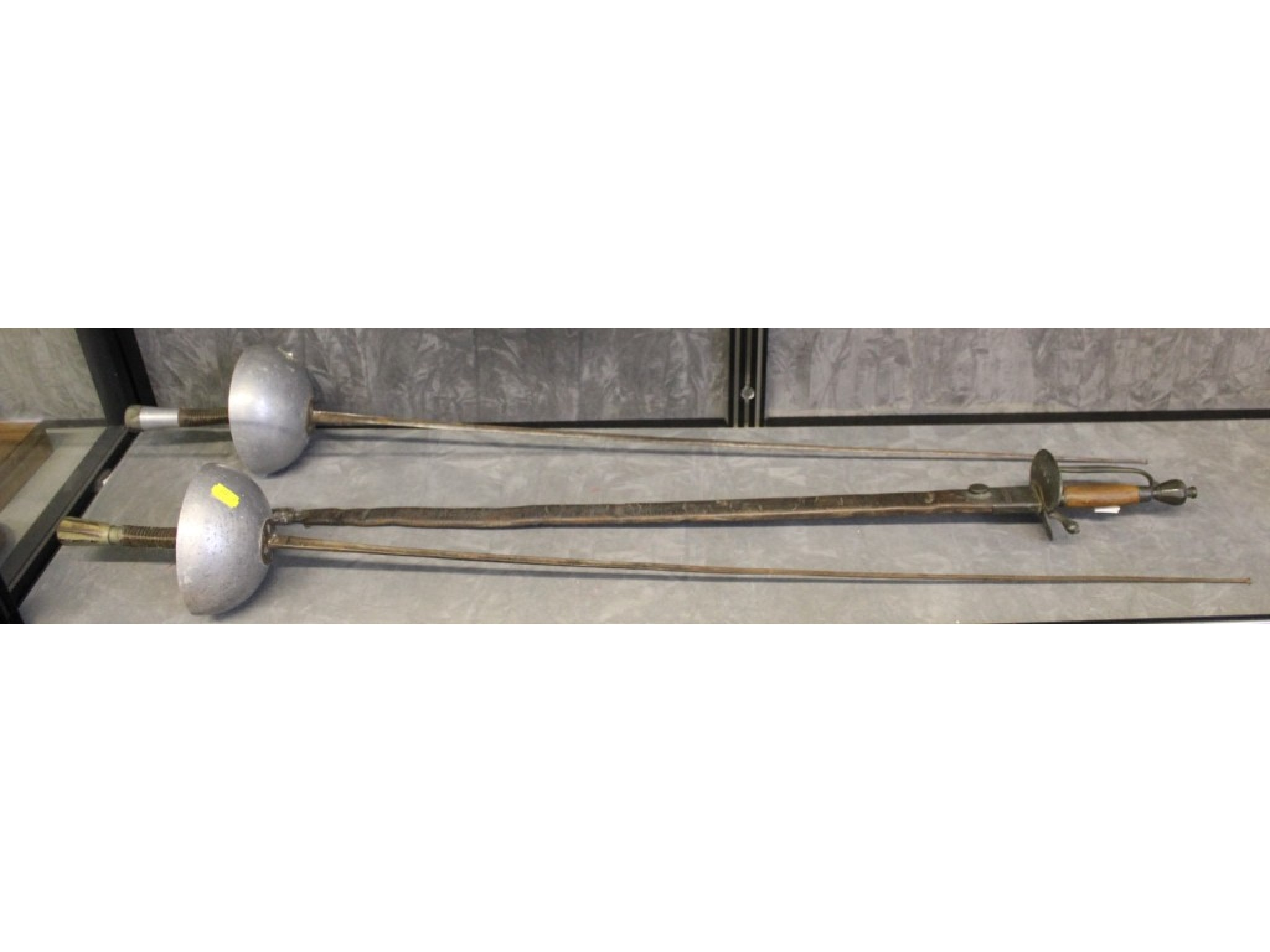 A Naval type sword, in leather scabbard, and two fencing Épée swords