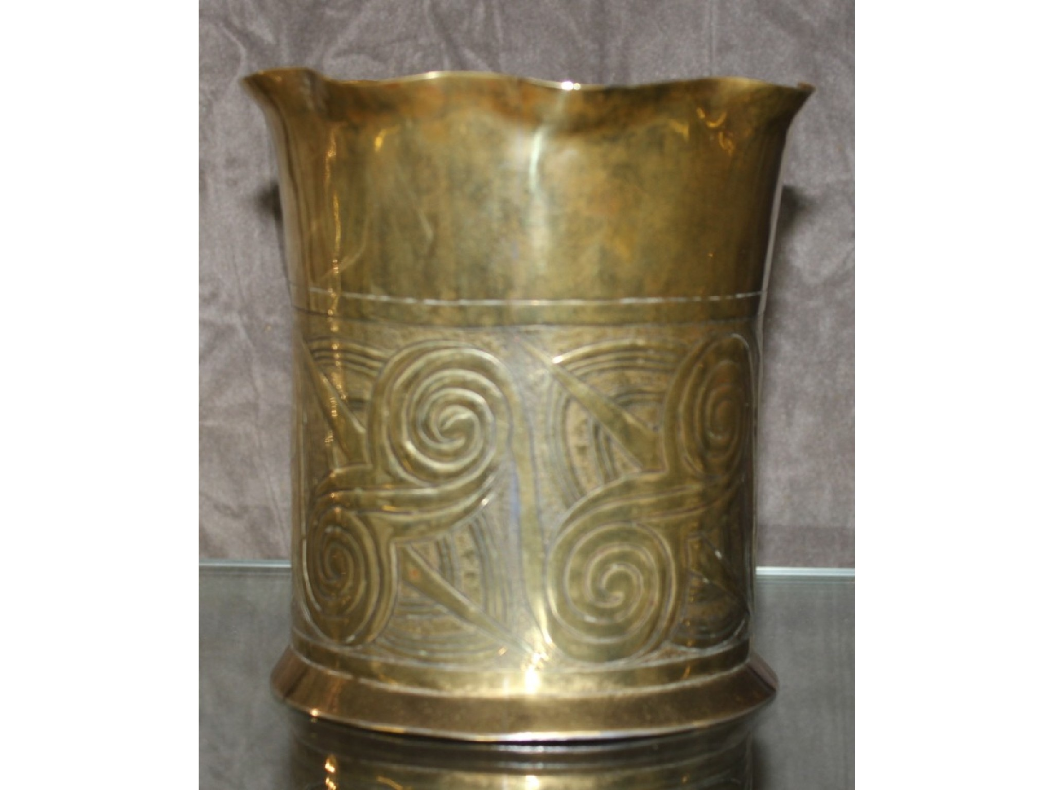 An Arts and Crafts hammered brass vase with a Celtic design, by Keswick School of Industrial Arts, marked KSIA to the base