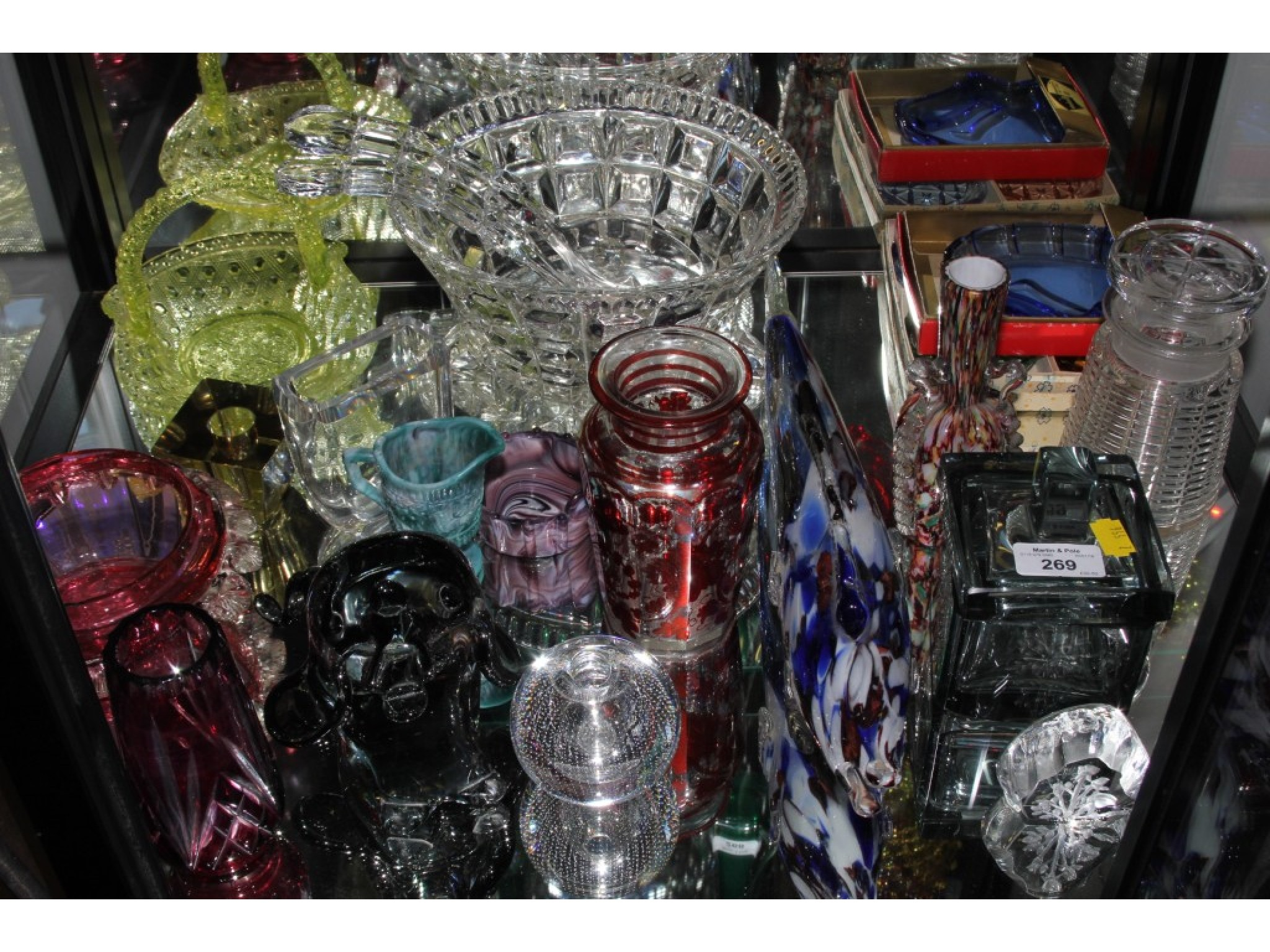 A collection of various glassware, including slag glass, cranberry glass and Murano