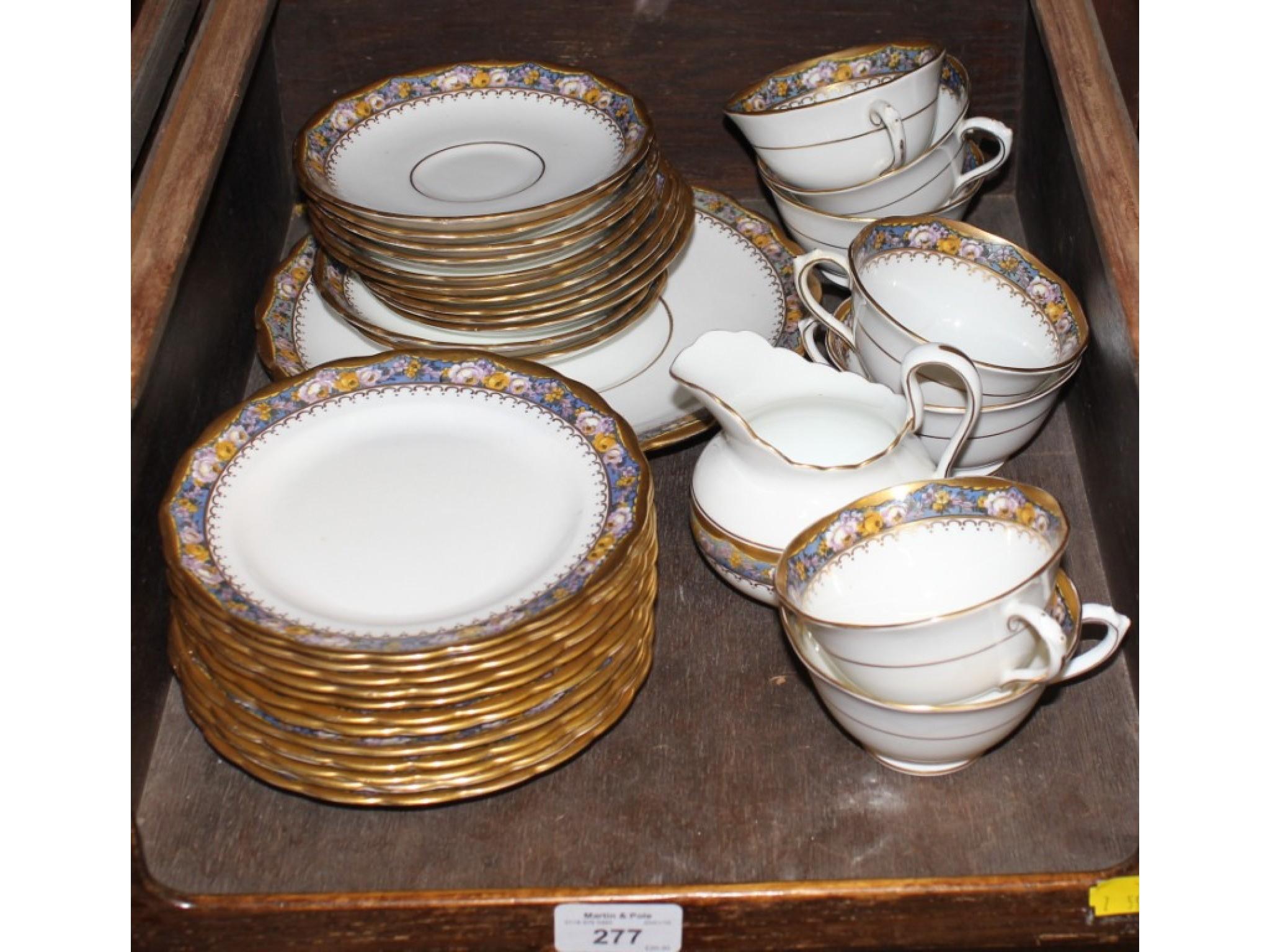 A Tuscan porcelain tea service comprising thirty-four pieces