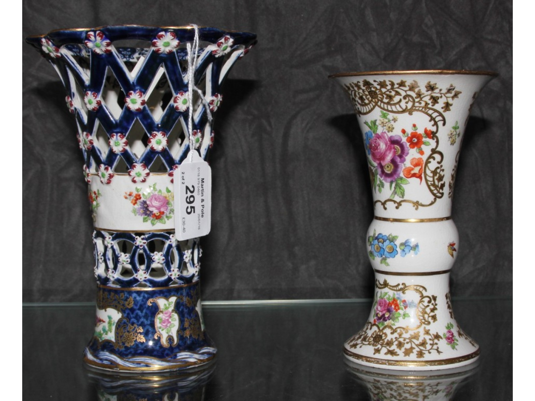 A lattice work open vase in the style of Worcester with powder blue ground, painted with exotic birds and flowers, repaired, 18c