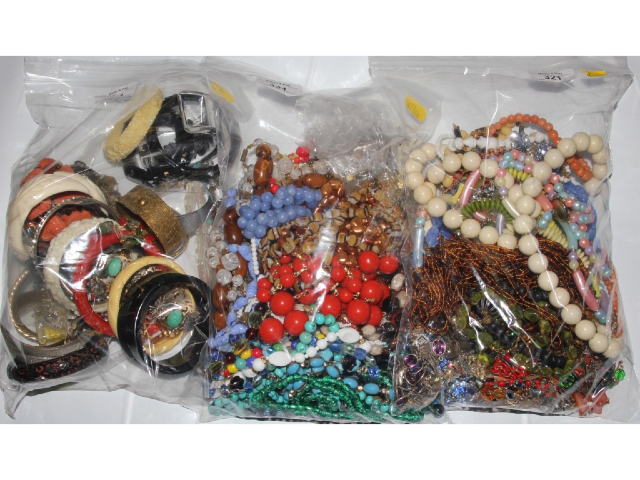 Three large bags of costume jewellery