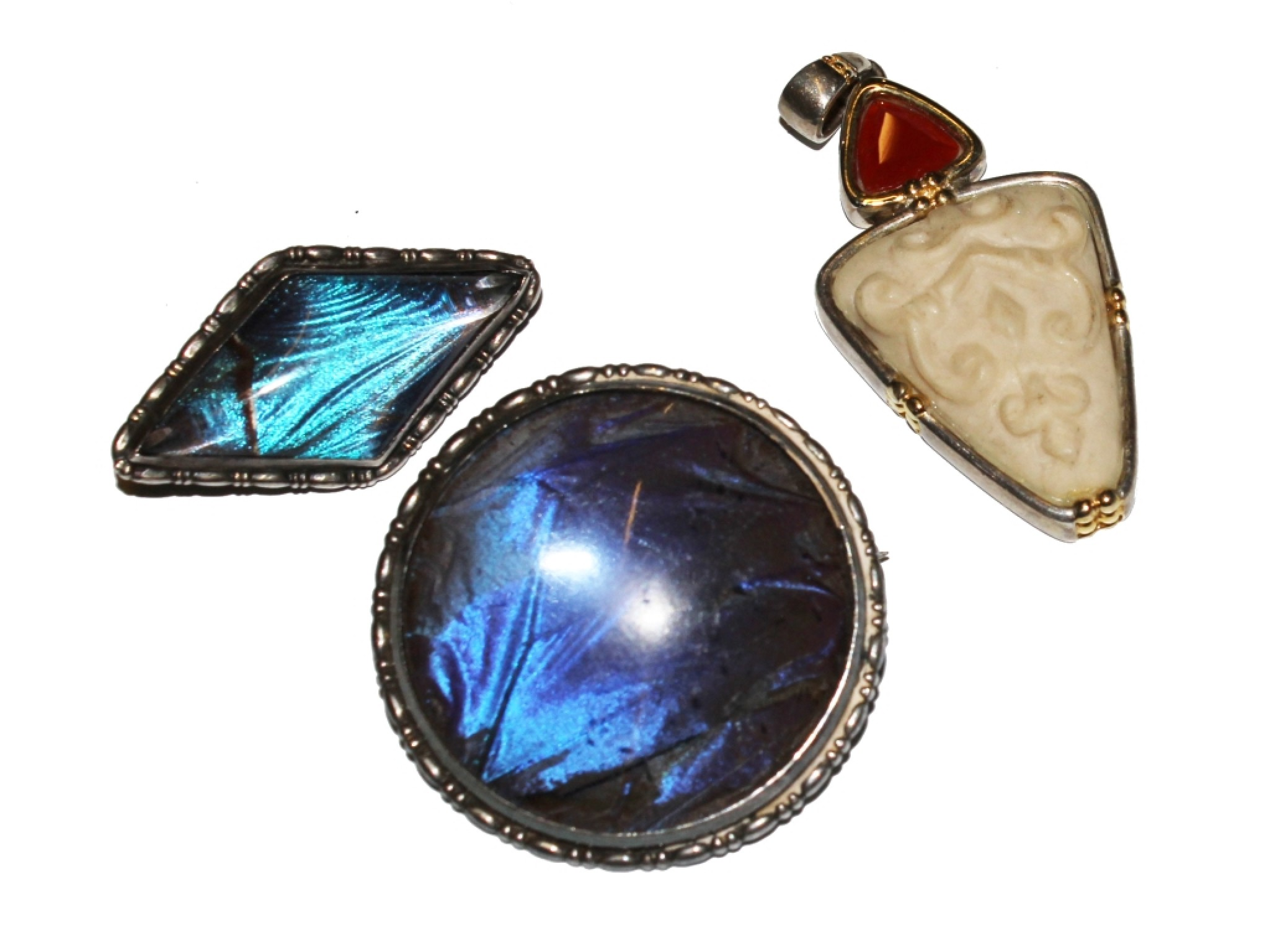 Two silver and butterfly wing brooches, etc