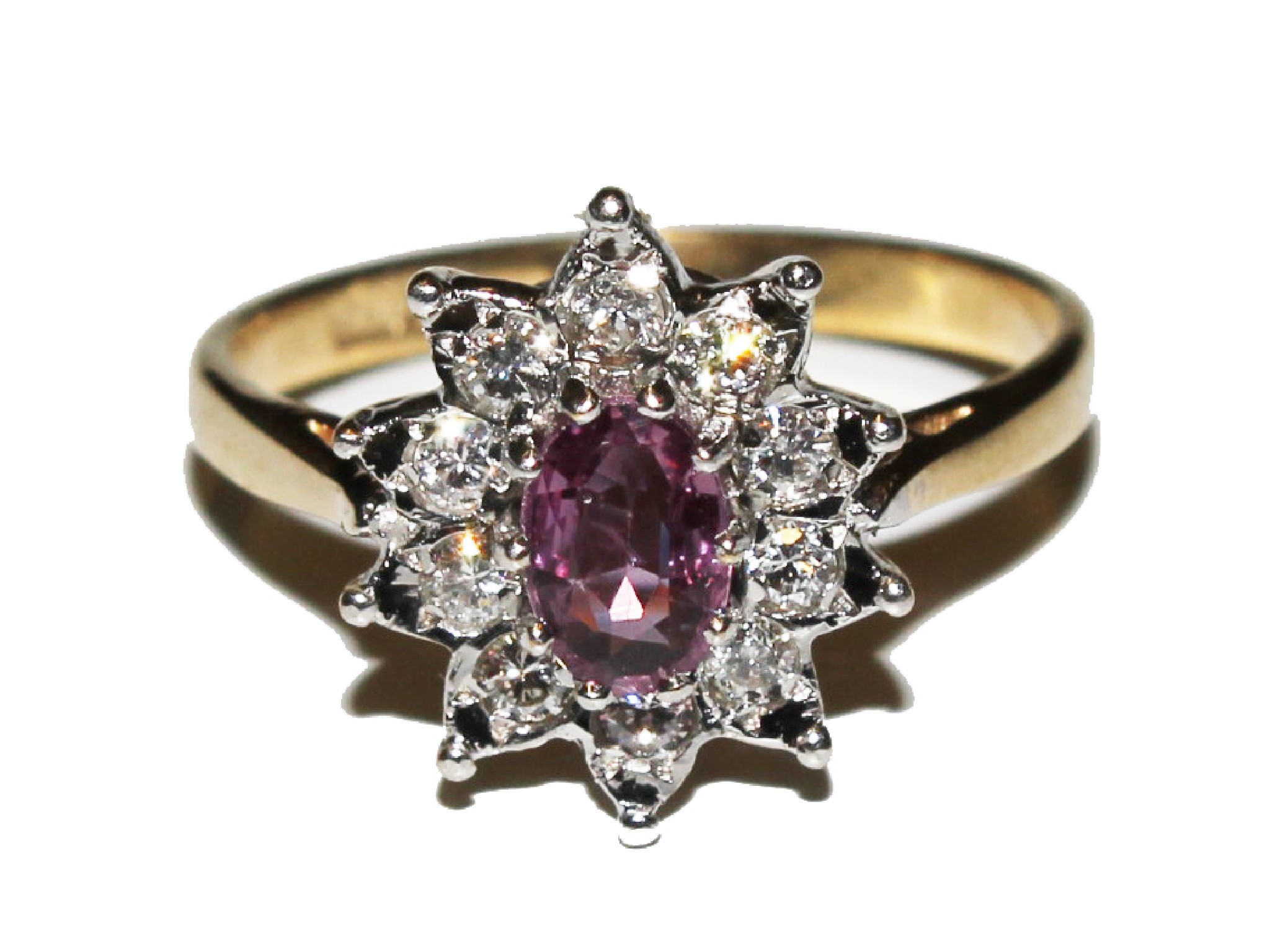 A 9 carat gold, ruby and diamond ring