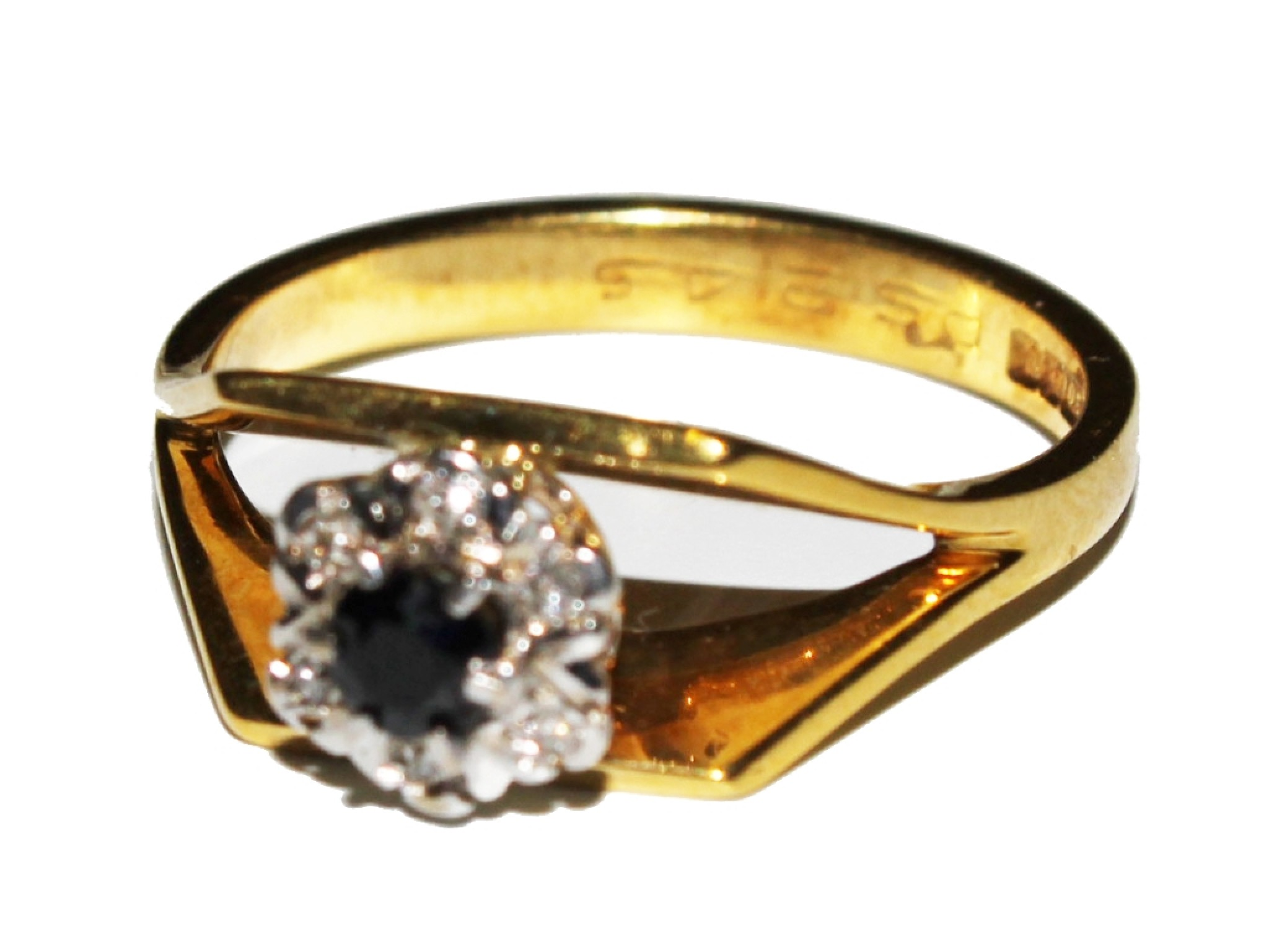 A diamond and sapphire cluster ring set in 18 carat gold