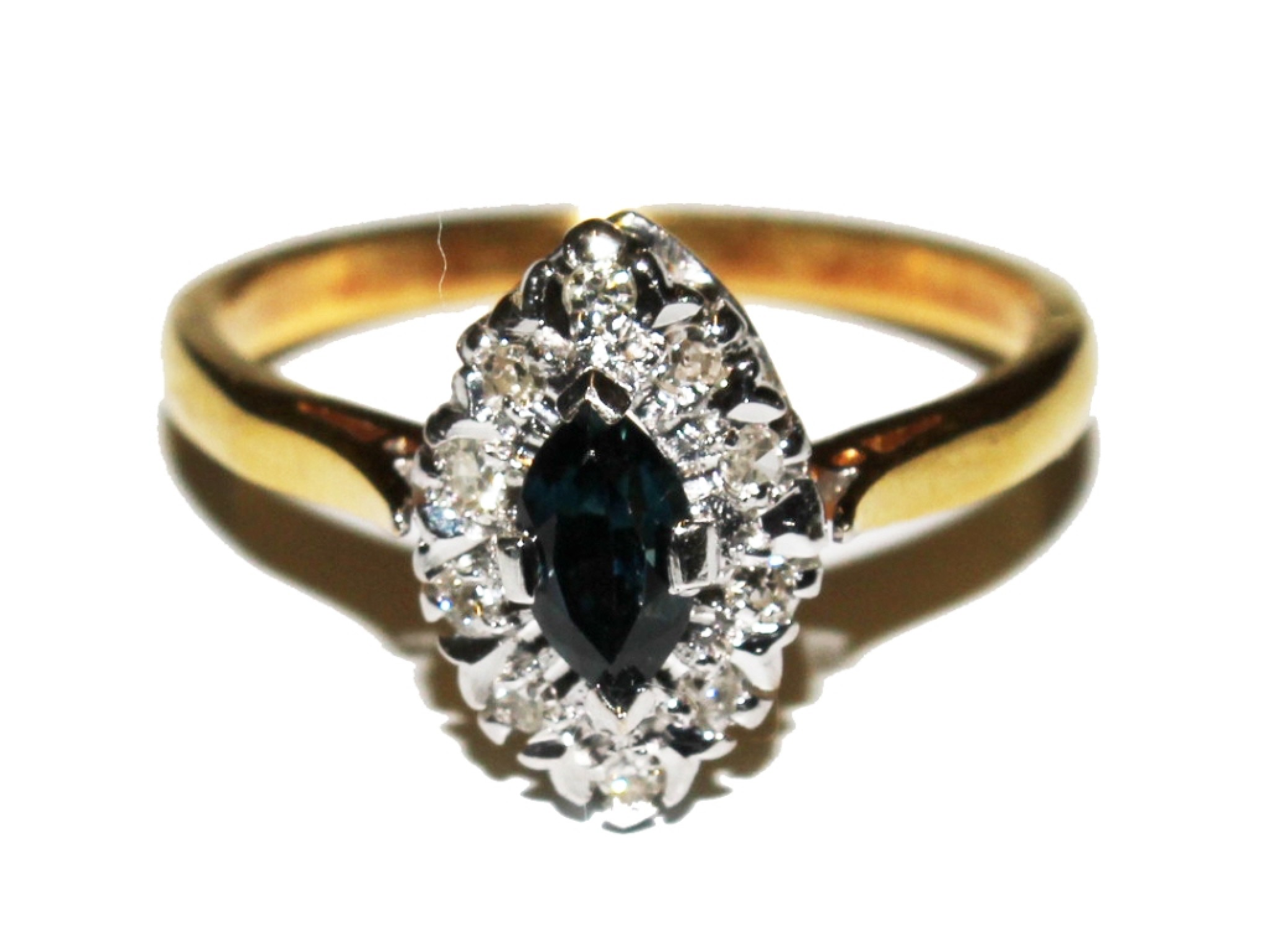 A diamond and sapphire oval cluster ring set in 18 carat gold