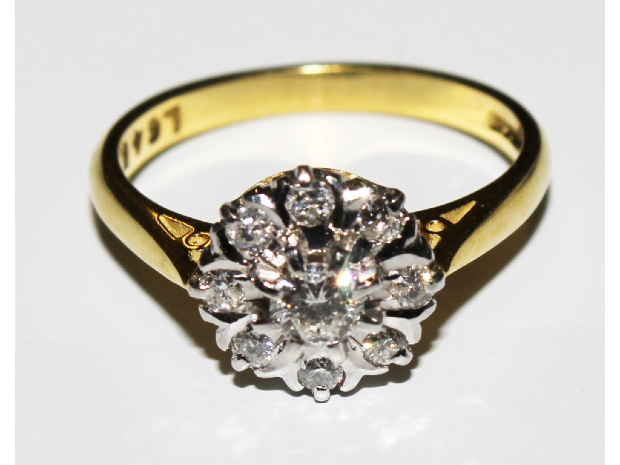 A diamond cluster ring set in 18 carat gold