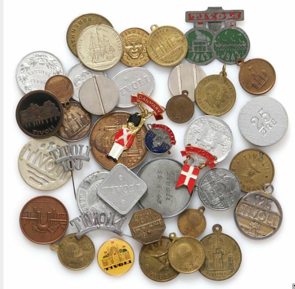 Small lot of various tokens, medals, needles and entrance tokens with relation to Tivoli, in total 39 pcs