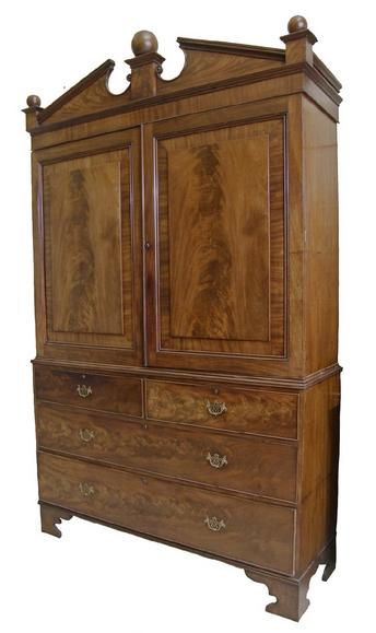 Extremely large and impressive 19th century flame mahogany linen press,