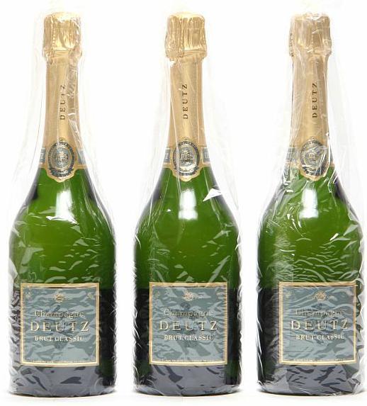 12 bts. Champagne Brut, Deutz A (hf/in). Oc.