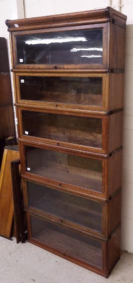 Globe Wernicke six tier glass fronted sectional bookcase comprising six matched glass sections and top (no base)